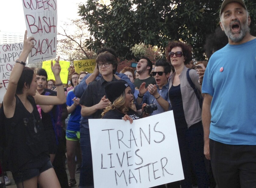 After North Carolina lawmakers approved controversial anti-discrimination rules, people protest outside the Executive Mansion in Raleigh on March 24.