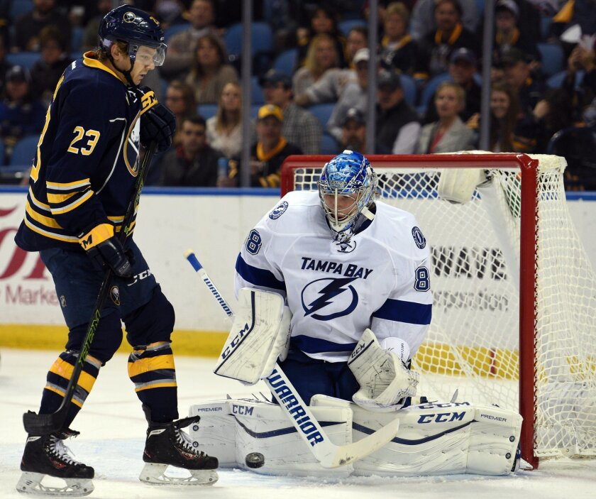 Buffalo Sabres center Sam Reinhart (23) tries to collect a rebound after a save from Tampa Bay Lightning goaltender Andrei Vasilevskiy (88), of Russia, during the first period of an NHL hockey game, Thursday Nov. 5, 2015, in Buffalo, N.Y. (AP Photo/Gary Wiepert)