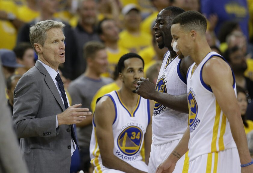 Golden State Warriors head coach Steve Kerr, left, talks with forward Draymond Green (23) and guard Stephen Curry (30) during the second half of Game 1 of basketball's NBA Finals against the Cleveland Cavaliers in Oakland, Calif., Thursday, June 2, 2016. (AP Photo/Marcio Jose Sanchez)