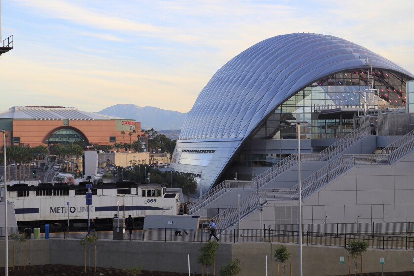 A southbound Metrolink commuter train pulls into the Anaheim Regional Transportation Intermodal Center early Monday morning.
