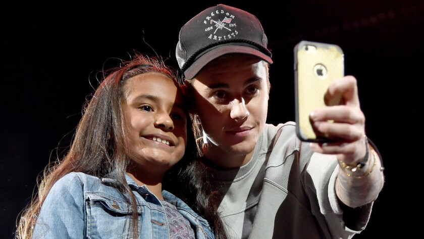 Justin Bieber takes a selfie with a fan
