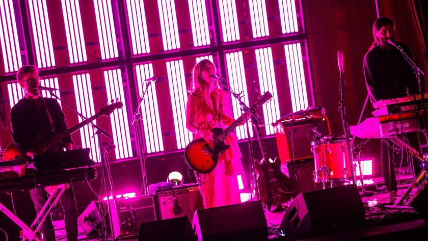 Feist, center, performs Friday night at the Palace Theatre in downtown Los Angeles.
