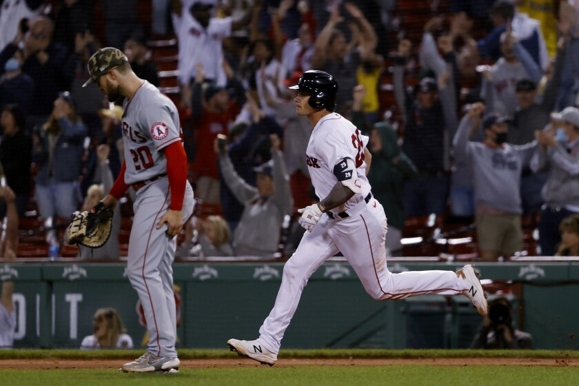 The Red Sox's Bobby Dalbec rounds the bases past Angels first baseman Jared Walsh after homering on May 14, 2021.