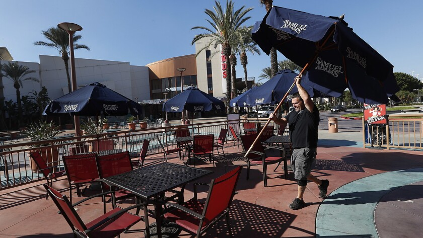Mario Mancuso, Owner of Anna's Pizza, located in The Lakes Entertainment Center in West Covina, sets