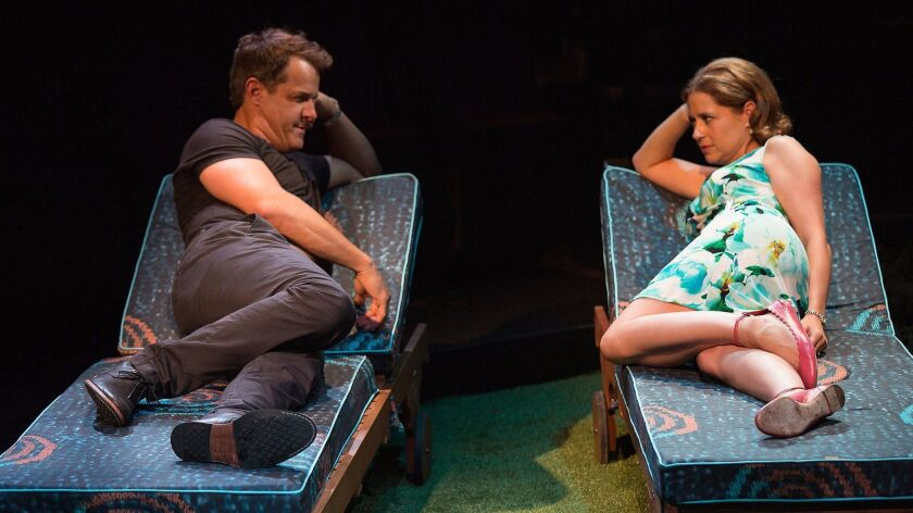 """Josh Stamberg appears as Gerald and Jenna Fischer as Corky in the world premiere of Steve Martin's """"Meteor Shower"""" at the Old Globe Theatre."""