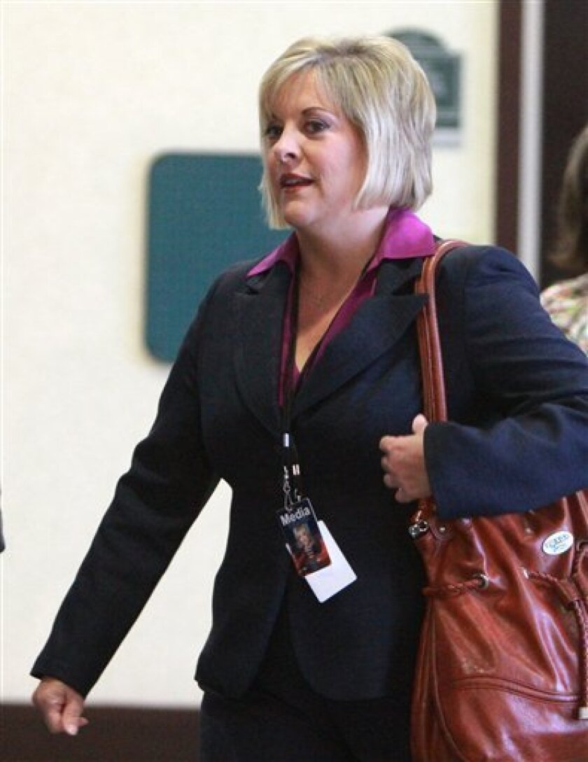 """FILE - In this May 24, 2011 file photo, CNN Headline News host Nancy Grace arrives at the Orange County Courthouse for the trial of Casey Anthony, in Orlando, Fla. The former prosecutor took up the cause of 2-year-old Caylee Anthony when she was missing, spending hour upon hour on the case as mother Casey was charged with the girl's murder. Grace harbored nothing but disdain for """"tot mom,"""" as she called Anthony, and with Grace in the lead HLN's coverage of Anthony's acquittal brought the network the largest audience in its 29-year-history. (AP Photo/Joe Burbank, file)"""