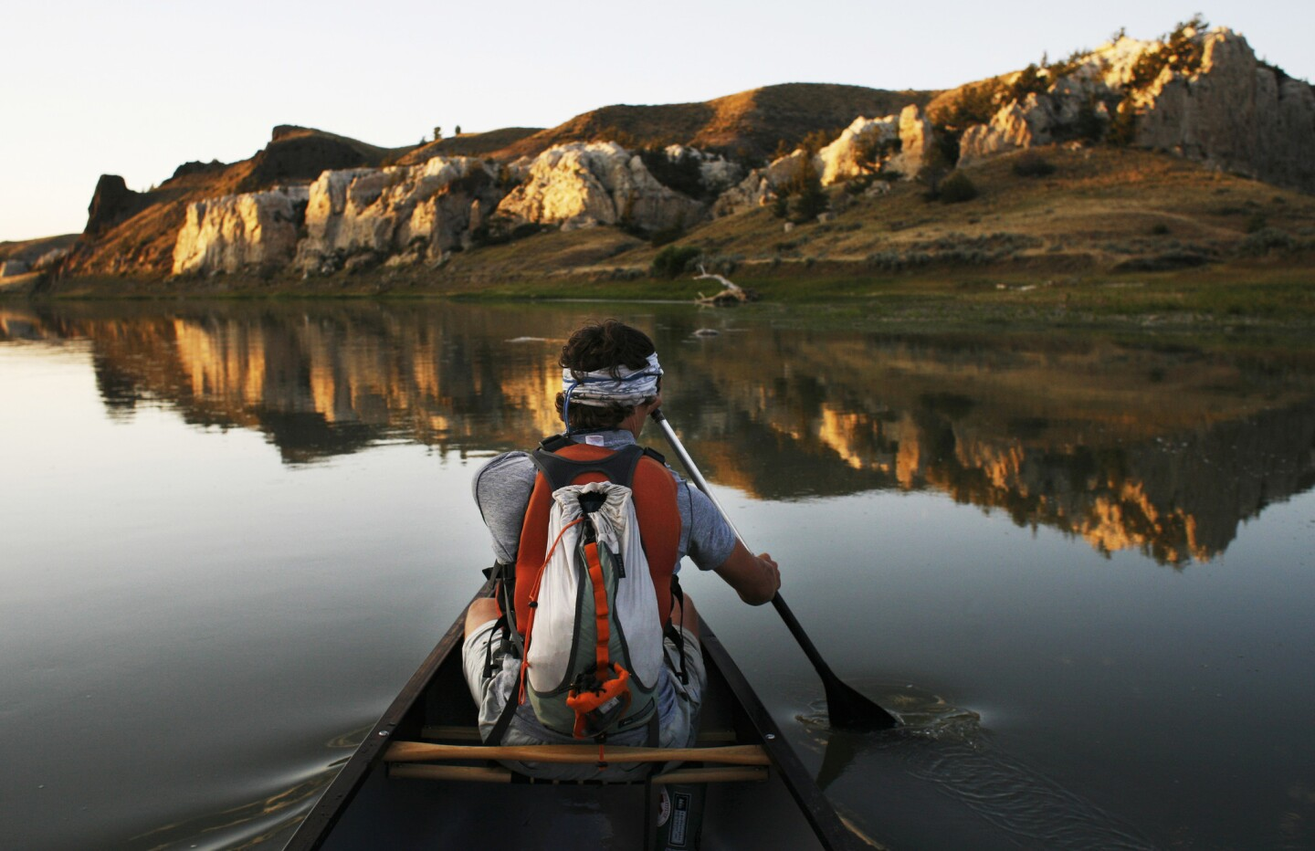 Morning canoe paddle in front of the White Cliffs on Montana's Missouri River off the Lewis & Clark Trail.