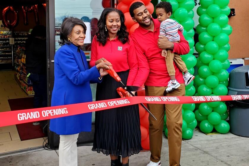 Chanda Simon-Thomas and Kenji Thomas open their 7-Eleven  with Rep. Maxine Waters