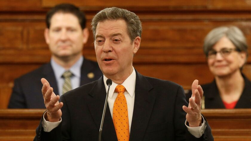 Kansas Gov. Sam Brownback delivers his annual State of the State address on the floor of of the Kans