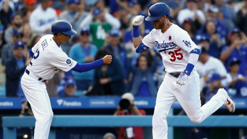 LOS ANGELES, CALIF. - MAY 27: Los Angeles Dodgers third base coach Dino Ebel (12) congratulates Los