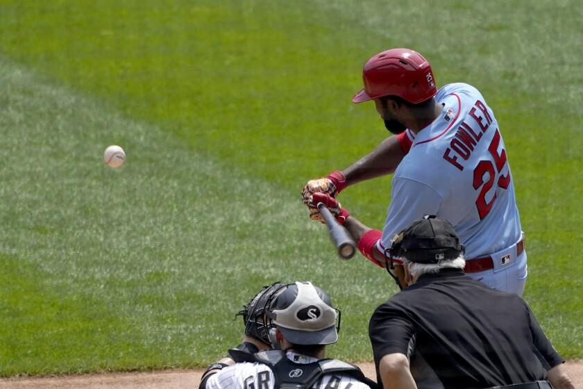 St. Louis Cardinals' Dexter Fowler swings into a two-run single off Chicago White Sox starting pitcher Lucas Giolito, during the first inning in Game 1 of a double-header baseball game Saturday, Aug. 15, 2020, in Chicago. (AP Photo/Charles Rex Arbogast)