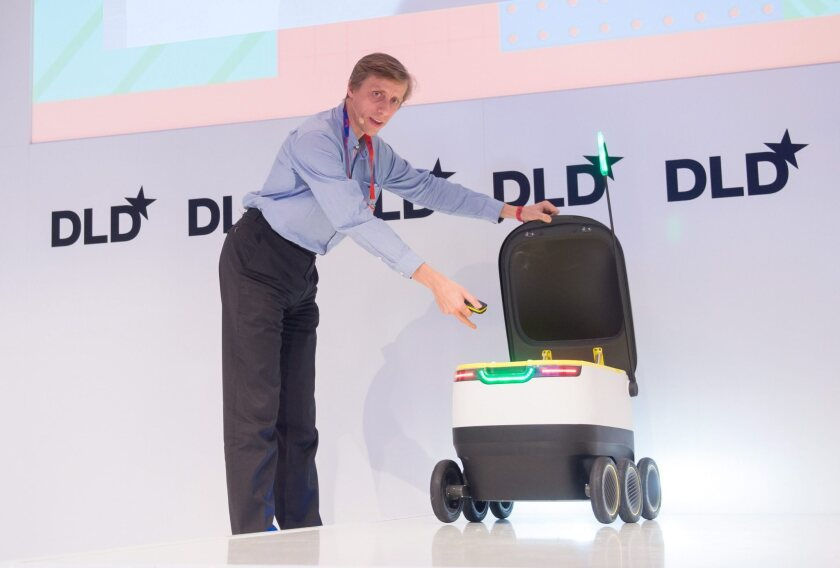 Ahti Heinla of Starship Technologies presents a wheeled delivery robot at the Digital-Life-Design conference in Munich, Germany, in January 2016.