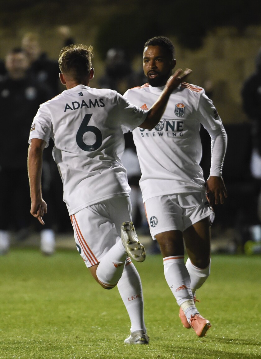 Charlie Adams (6) is congratulated by Elijah Martin after scoring first San Diego Loyal goal ever.