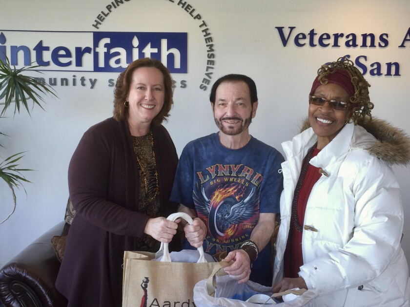 "The American Association of University Women (AAUW) Del Mar-Leucadia Branch donated gloves, mittens, scarves and knit caps to nonprofit Interfaith Community Services to help local homeless veterans as part of the branch's ""Time for Action"" program. From left: Sharon Corbett-Parry, co-president, AAUW Del Mar-Leucadia Branch; Roy Gardiner, resident coordinator, Interfaith Community Services, who accepted the donations at the nonprofit's Oceanside center; and Patricia Johnson-Khalifa, program director, AAUW Del Mar-Leucadia branch. Visit delmarleucadia-ca.aauw.net."