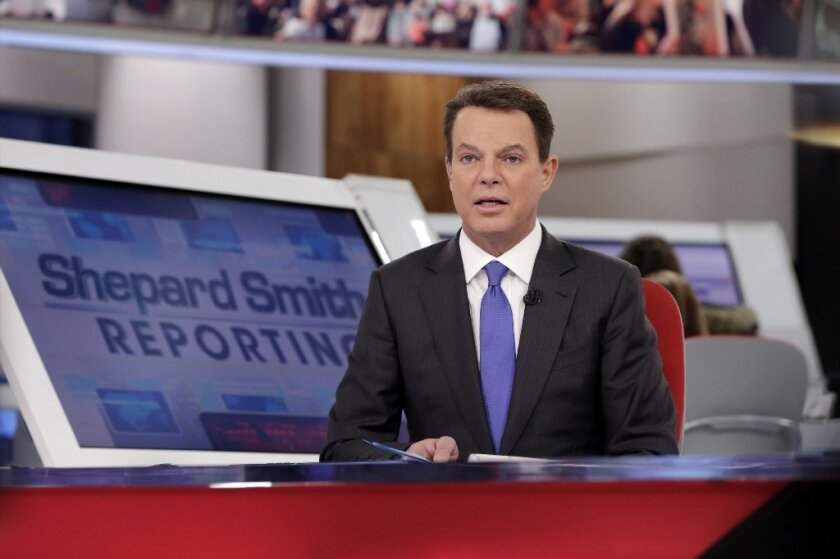 """FILE - In this Jan. 30, 2017 file photo, Fox News Channel chief news anchor Shepard Smith broadcasts from The Fox News Deck during his """"Shepard Smith Reporting"""" program, in New York."""