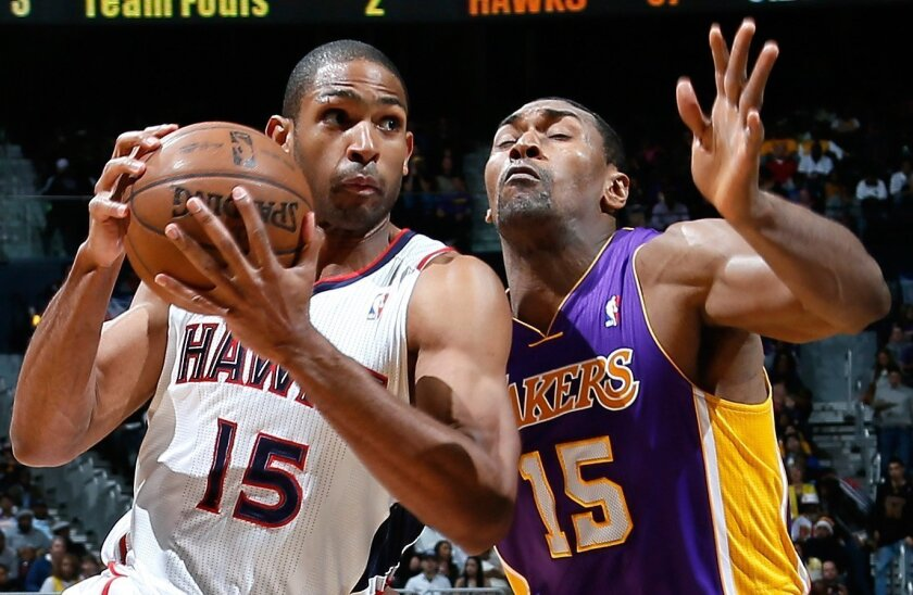 Metta World Peace, right, is sidelined for at least six weeks because of a knee injury.