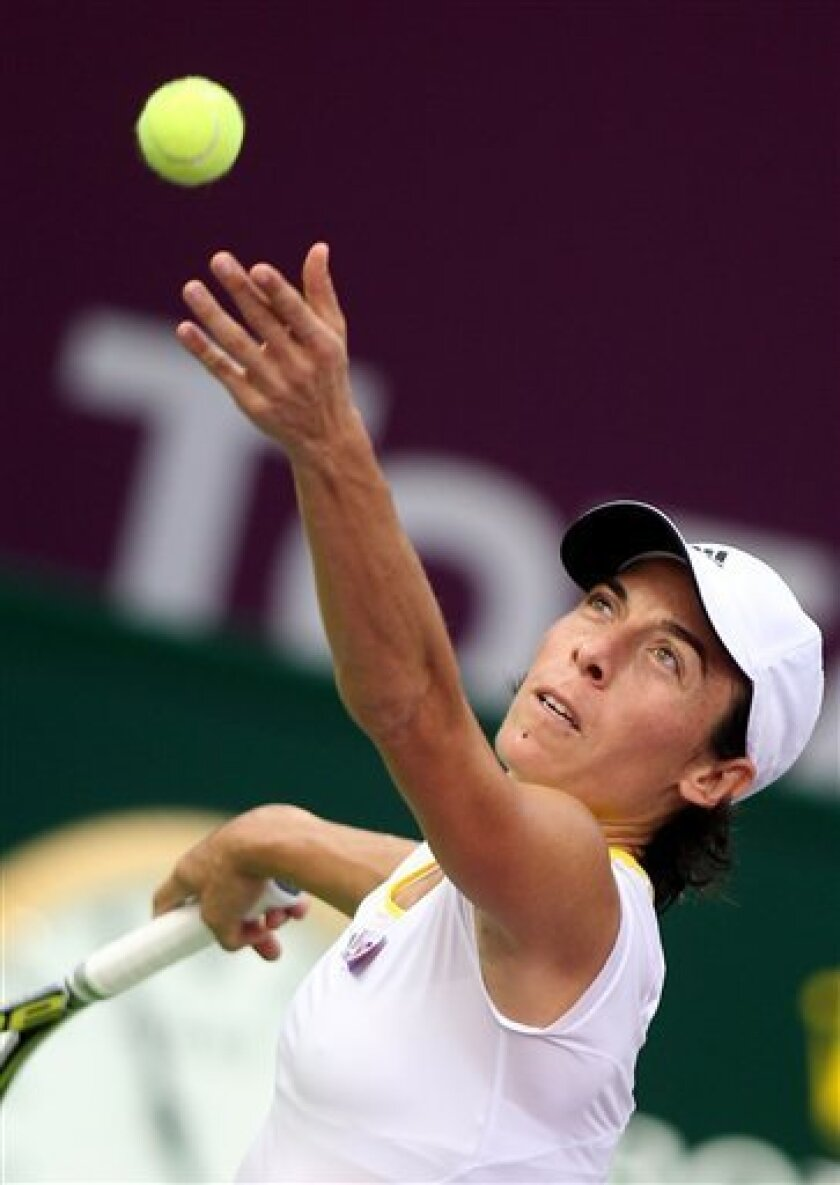 Francesca Schiavone of Italy serves the ball to France's Marion Bartoli during the Second day of the WTA Qatar Ladies Open in Doha, Qatar, Tuesday, Feb. 12, 2013. (AP Photo/Osama Faisal)