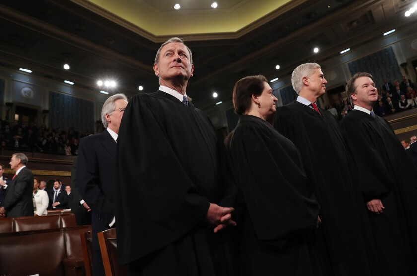 Supreme Court Justices John Roberts, Elena Kagan, Neil Gorsuch and Brett Kavanaugh