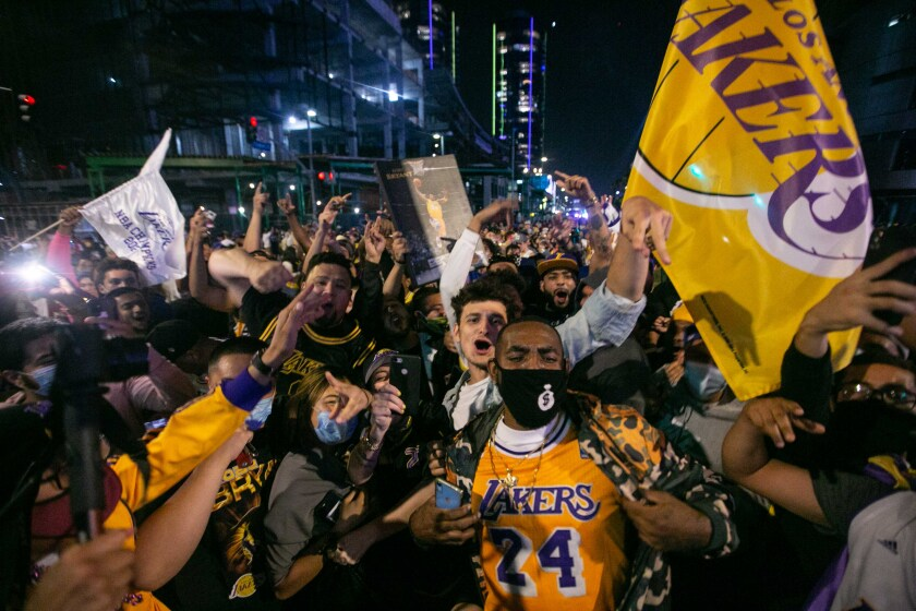 Lakers fans celebrate near the Staples Center after the team's championship win Oct. 11.