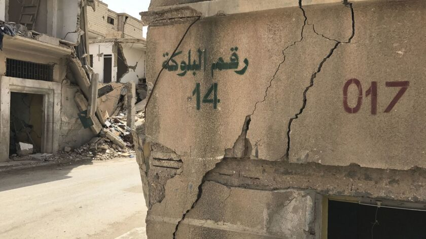 Islamic State stenciled new numbers on buildings and streets as it established a government over Pal