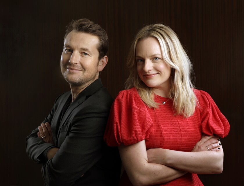 """""""The Invisible Man"""" director Leigh Whannell and star Elisabeth Moss photographed in Los Angeles on Feb. 12."""