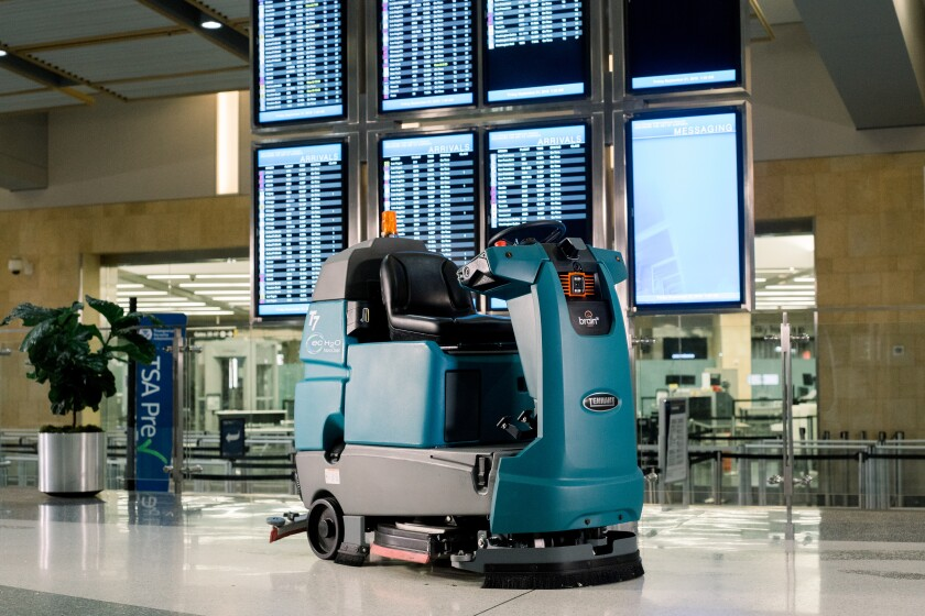 A Tennant Co. floor scrubber powered by Brain Corp.'s operating system makes the rounds at San Diego International Airport.