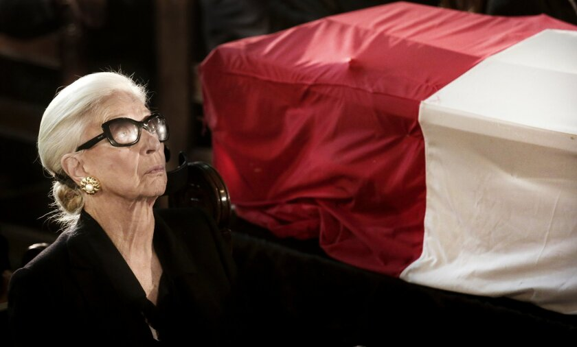 Laila Boutros-Ghali, the wife of former U.N. Secretary-General Boutros Boutros-Ghali, sits near his coffin during his funeral in Al-Boutrossiya Church, at the main Coptic Cathedral complex in Cairo, Egypt, Thursday, Feb. 18, 2016.  Boutros-Ghali, a veteran Egyptian diplomat who helped negotiate his
