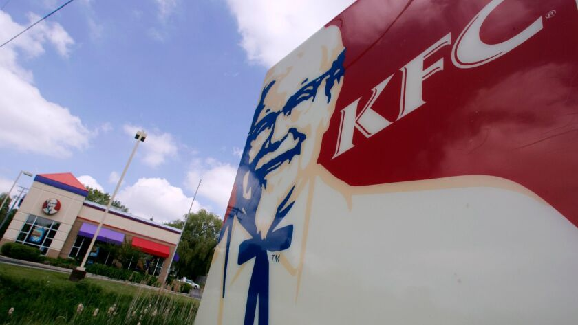 The image of Colonel Sanders looms over a Kentucky Fried Chicken franchise in Chesterland, Ohio on T