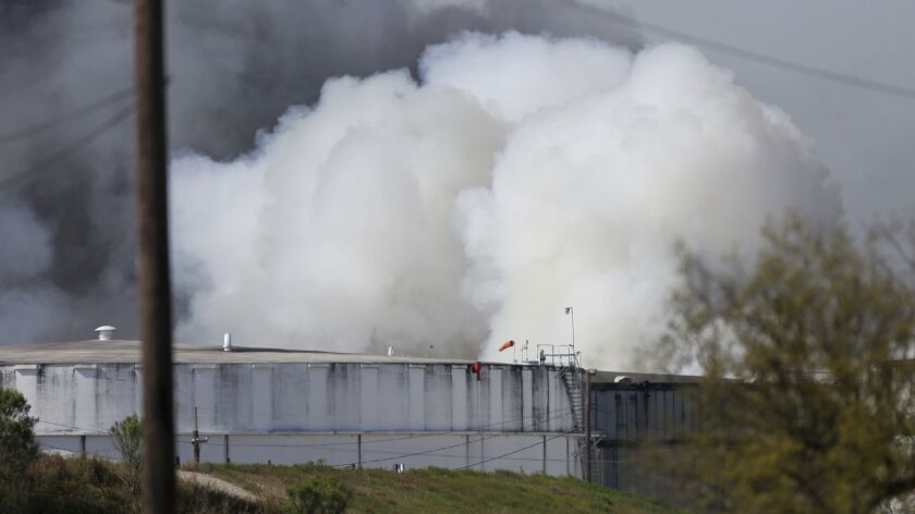 A petrochemical fire at Intercontinental Terminals Co. reignited as crews tried to clean out the chemicals that remained in the tanks on Friday in Deer Park, Texas.