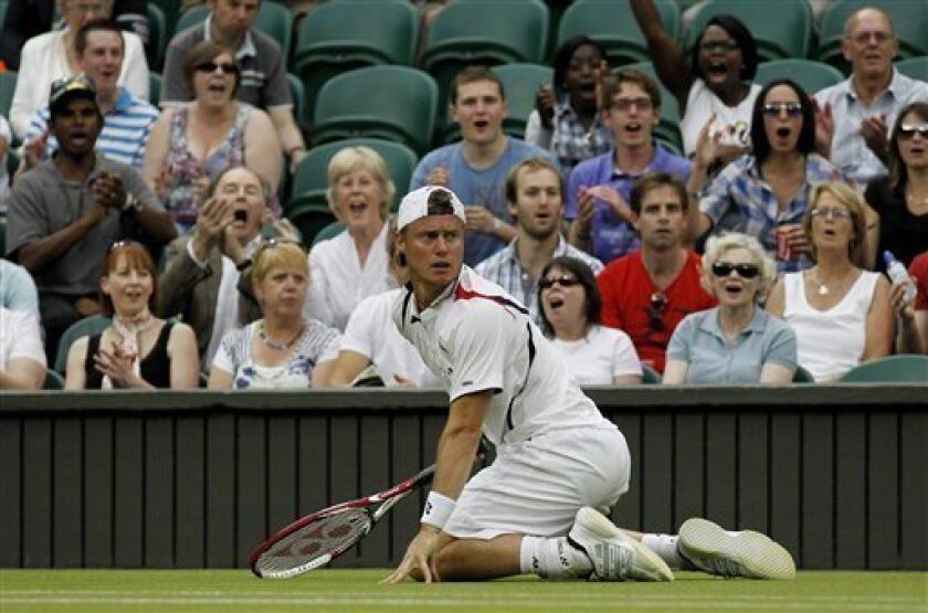 Australia's Lleyton Hewitt reacts after falling to the ground during the match against Sweden's Robin Soderling at the All England Lawn Tennis Championships at Wimbledon, Thursday, June 23, 2011. (AP Photo/Anja Niedringhaus)