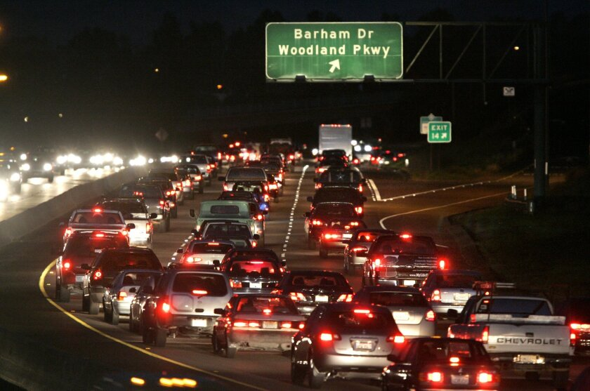 Traffic was seen backed up at 6 p.m. yesterday heading east on state Route 78 near Barham Drive. The highway was clogged during rush hour 243 days last year, or just about every workday.  Charlie Neuman / Union-Tribune