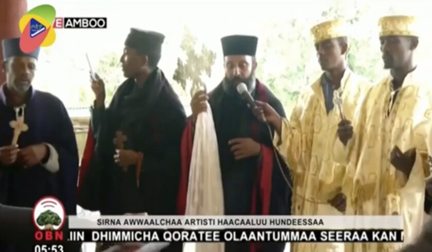 In this image taken from OBN video, the funeral for Ethiopia singer Hachalu Hundessa takes place in Ambo, Ethiopia, Thursday July 2, 2020. More than 80 people have been killed in unrest in Ethiopia after the popular singer Hachalu Hundessa was shot dead this week. He was buried Thursday amid tight security. He had been a prominent voice in anti-government protests that led to a change in leadership in 2018. (OBN via AP)