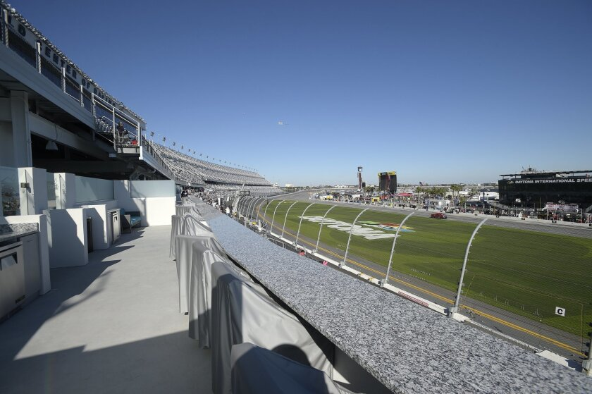 "In this Feb. 13, 2016 photo, a box suite is shown in the grandstands near the finish line of the at Daytona International Speedway in Daytona Beach, Fla. The project was such a massive undertaking that architects had to account for the curvature of the Earth. It also got its own nickname, ""Daytona"