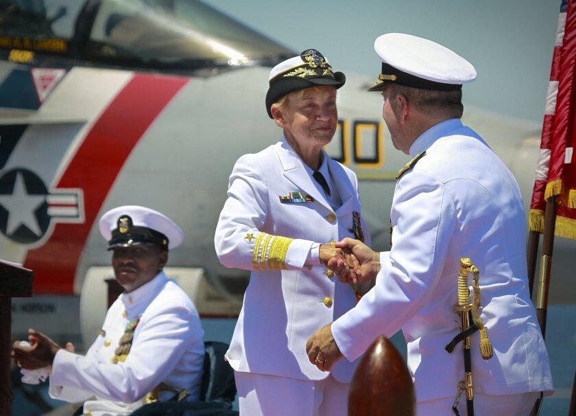 With Command Master Chief, Naval Inspector General Loran Bather  looking on, Vice Admiral Nora Tyson, the incoming commander of the U. S. Navy's Third Fleet, and the first woman to lead a U.S. Navy ship fleet shakes hands with Vice Admiral Kenny Floyd, the outgoing commander of the fleet. Floyd is