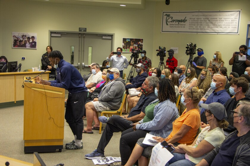 Coronado High School basketball team captain Wayne McKinney speaks during a special meeting.