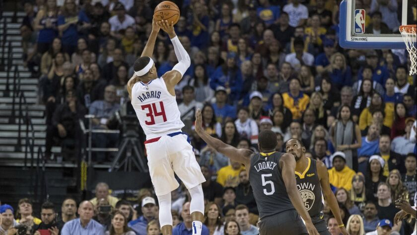 Clippers forward Tobias Harris (34) shoots against the Golden State Warriors in the fourth quarter on Sunday.