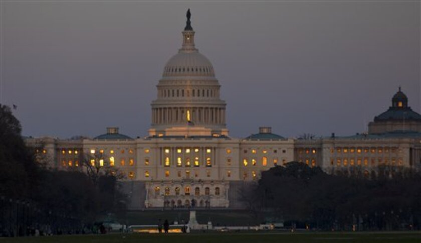 The setting sun is reflected in the windows of the U.S. Capitol, on Capitol Hill.(AP Photo/Alex Brandon)