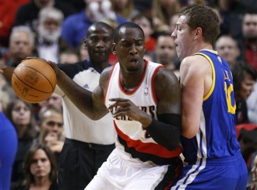 Golden State Warriors' David Lee, right, defends Portland Trail Blazers' J.J. Hickson during the first quarter of an NBA basketball game Wednesday, April 11, 2012, in Portland, Ore. (AP Photo/Rick Bowmer)
