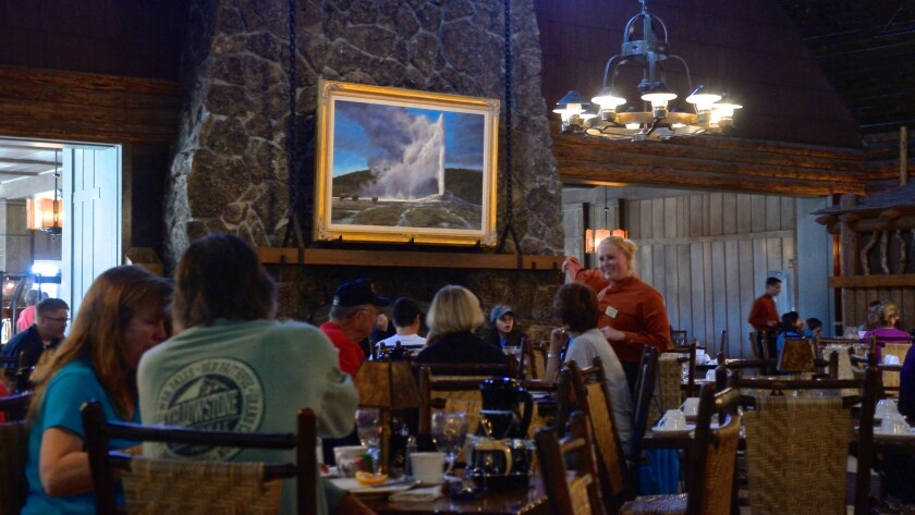 The Old Faithful Inn, open only in warmer months, stands next to the famous geyser in Yellowstone National Park in Wyoming.