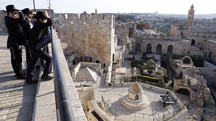 Orthodox Jews look at the Tower of David Museum in the Old City of Jerusalem on Nov. 30.