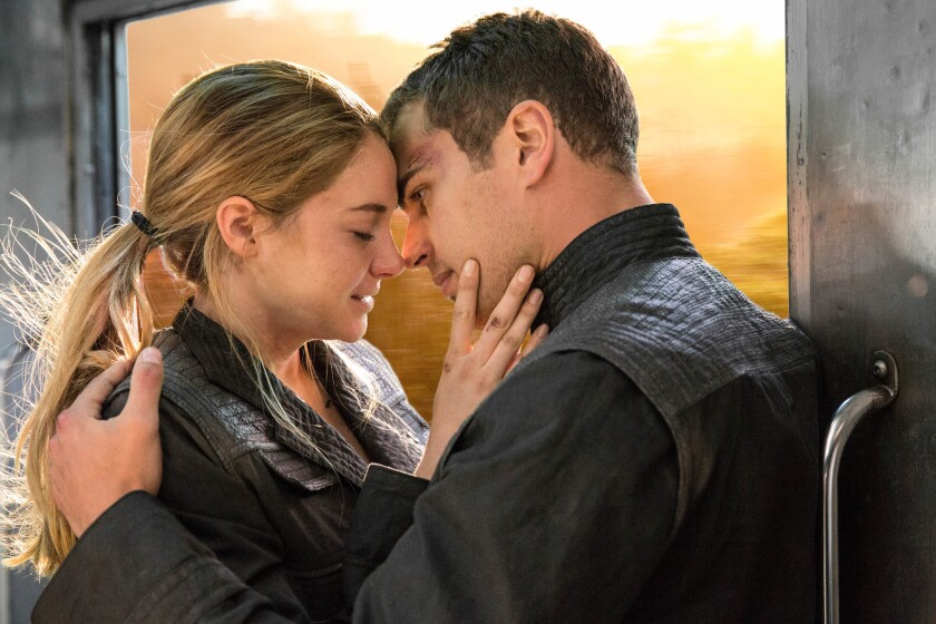 """Theo James, right, and Shailene Woodley in """"Divergent."""""""