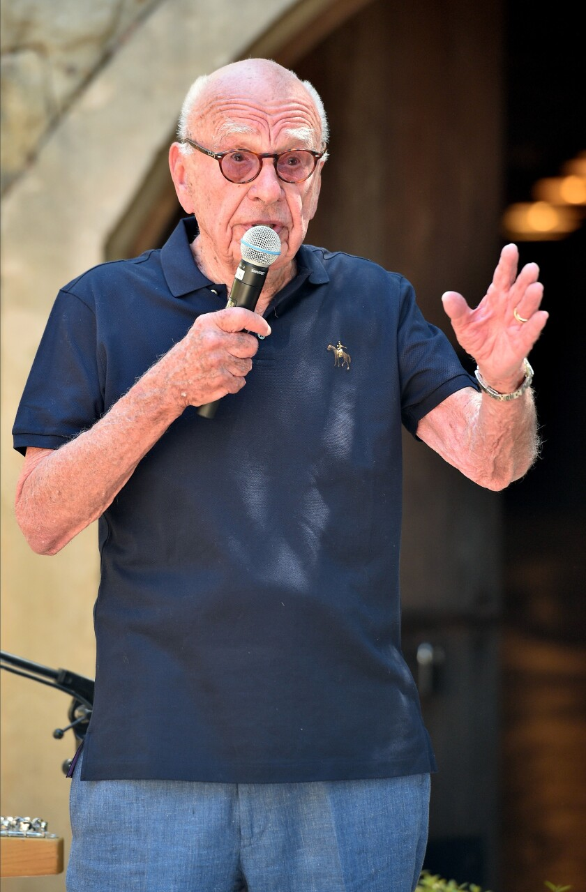 Rupert Murdoch in a polo shirt and jeans with a microphone at his Bel-Air winery's 30th anniversary party.