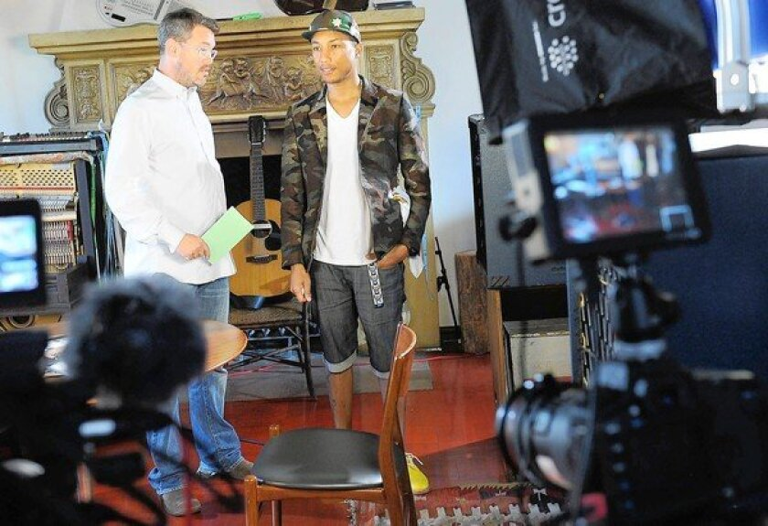 Uncommon Content has so far produced seven Web series, one of which features musician, producer and entrepreneur Pharrell Williams. Above, Uncommon Content Chief Executive Kevin Law, left, and Williams chat before a taping in Los Angeles.