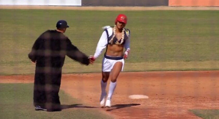 Charger Girl celebrates with Gorilla Guy after hitting a home run out of Tony Gwynn Stadium.