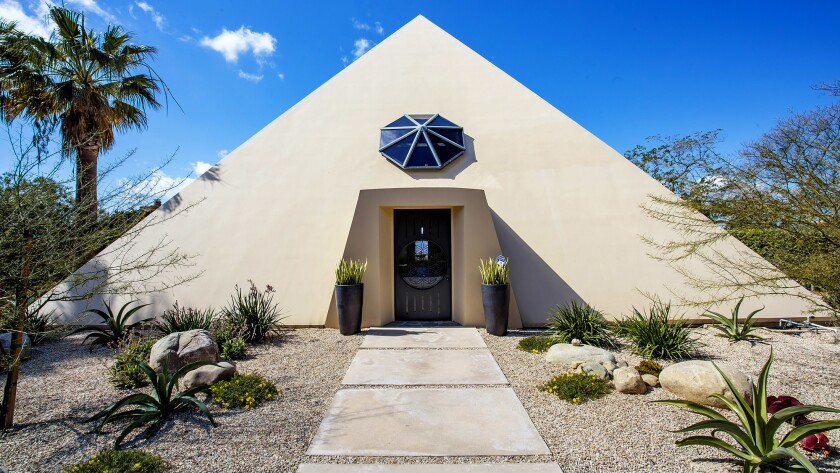 The pyramid-shaped home was custom-built in the 1980s for a pair of astronomy photographers.