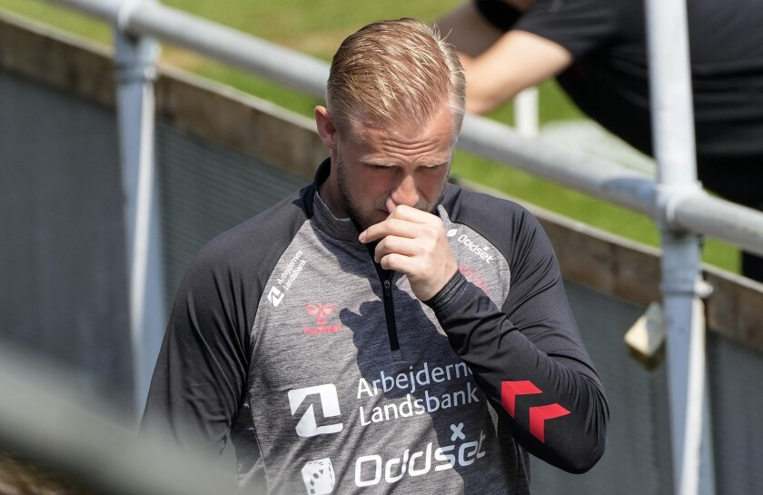 Denmark's goalkeeper Kasper Schmeichel arrives during a training session of Denmark's national team in Helsingor, Denmark, Saturday, June 19, 2021. (AP Photo/Martin Meissner)