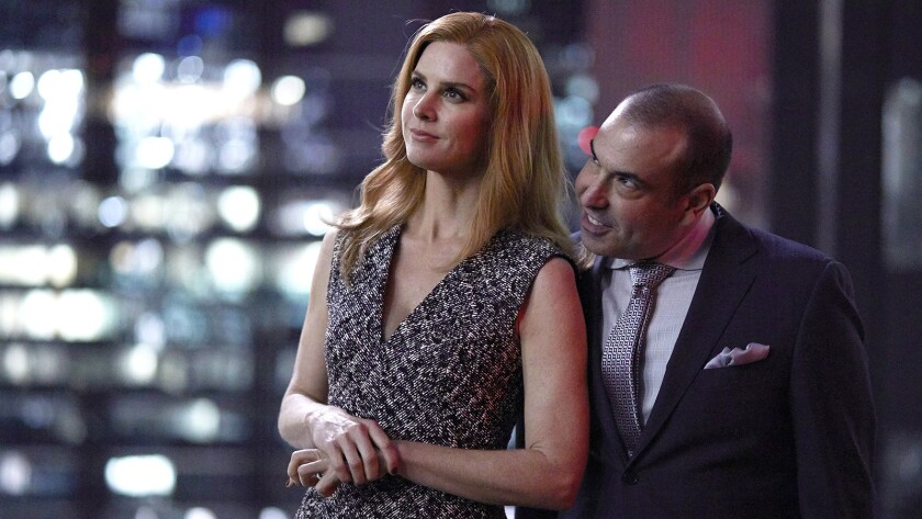 """Sarah Rafferty and Rick Hoffman in the 100th episode of the legal drama """"Suits"""" on USA."""