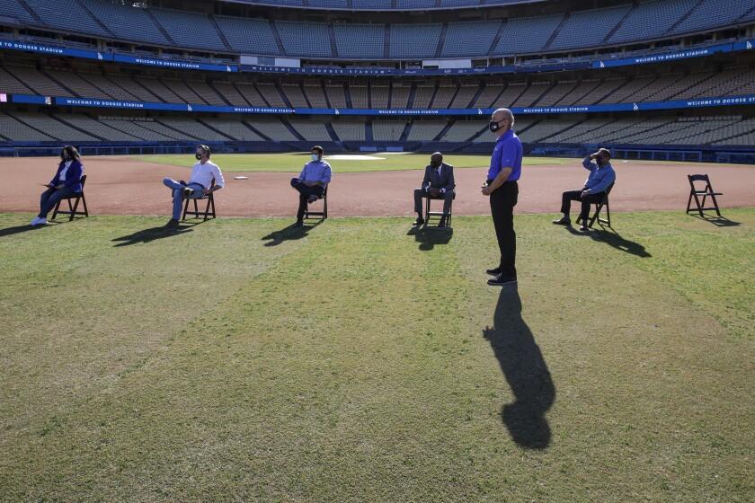 Gov. Gavin Newsom, L.A. Mayor Eric Garcetti among those launching the COVID-19 vaccination site at Dodger Stadium.