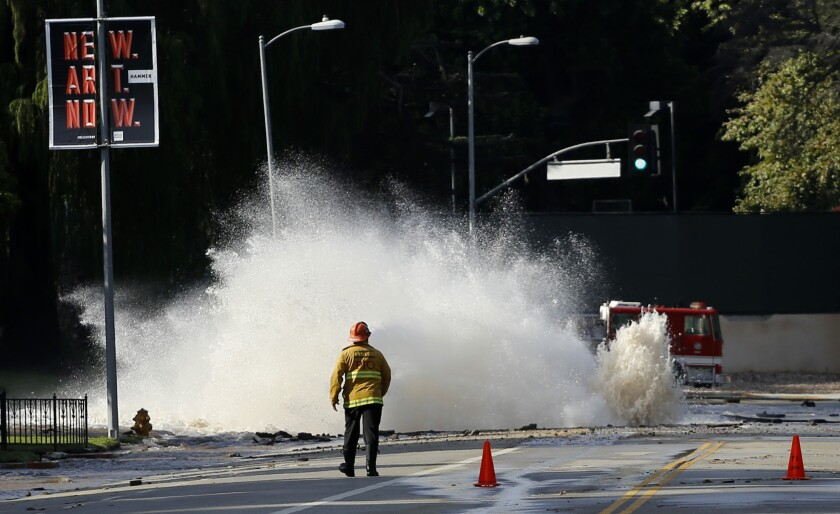 Water gushes from a broken pipe on Sunset Boulevard near UCLA in July 2014, flooding portions of the campus.