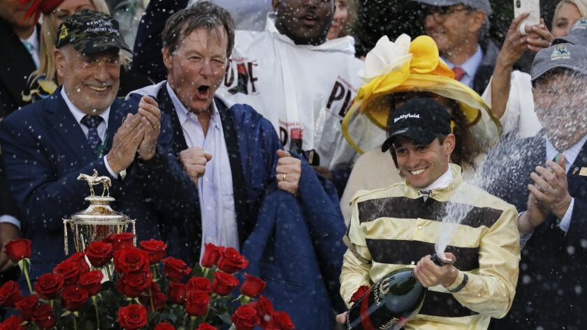 Flavien Prat celebrates after riding Country House to victory during the 145th running of the Kentuc